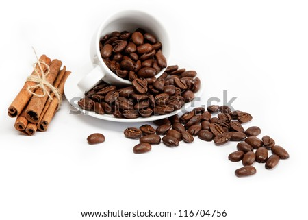 Cup with coffee beans isolated on white background. - stock photo