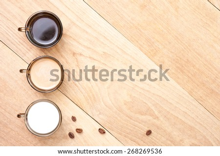 cup with coffee, milk and cocoa - stock photo