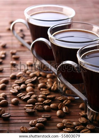 cup with fresh and tasty black coffee - stock photo