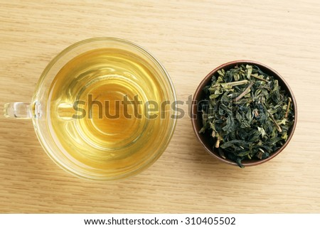 Cup with green tea on wooden background.View from the top. - stock photo