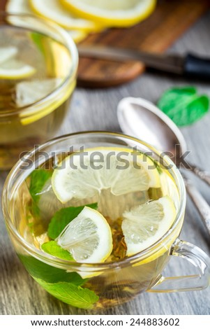 Cup with mint and lemon tea - stock photo