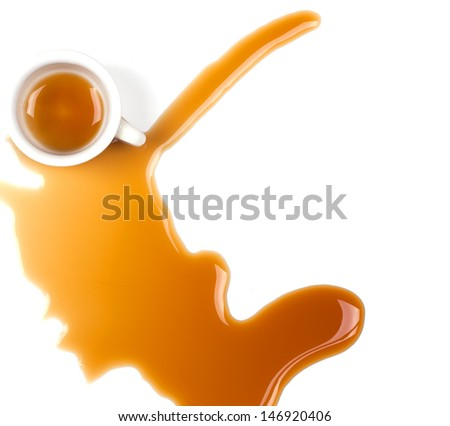 cup with spilled coffee - stock photo