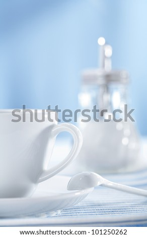 cup with spoon and cookies - stock photo