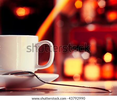 Cup with tea in night club