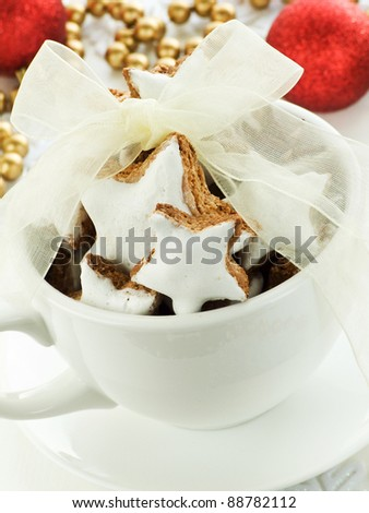 Cup with traditional christmas cinnamon cookies Zimtsterne. Shallow dof. - stock photo