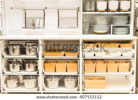 cupboard for a dishes with clean tableware in white colours - stock photo
