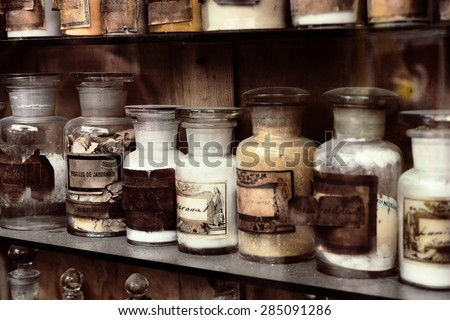 Cupboard with drugs in the old pharmacy - stock photo