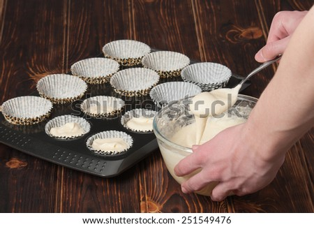 Cupcake Cooking Process. Preparation Stage. Liquid Dough. Baking Tray. - stock photo