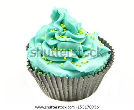Cupcake decorated with butter cream in green and blue
