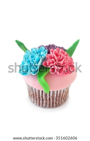 Cupcake decorated with candy flowers - stock photo