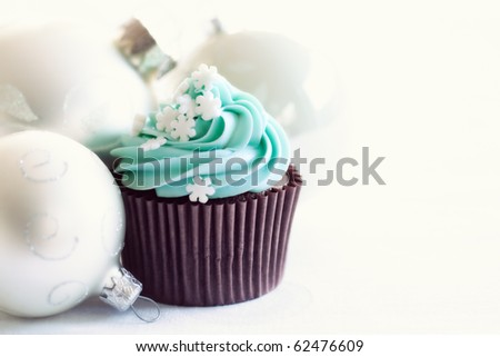 Cupcake decorated with sugar snowflakes - stock photo