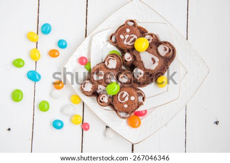 Cupcake for child party with colorful candy - stock photo