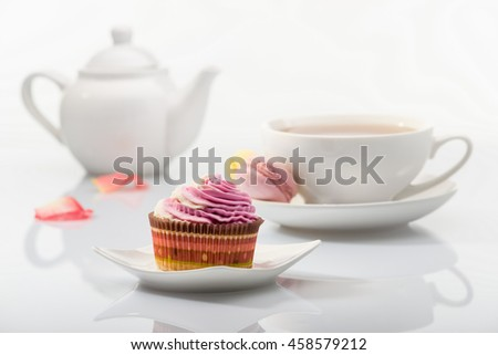 Cupcake on background tea set