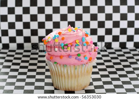cupcake on checkered background