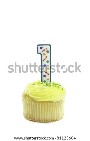 cupcake with a decorative candle in the form of a number one to celebrate a birthday or other occasion, isolated over white - stock photo