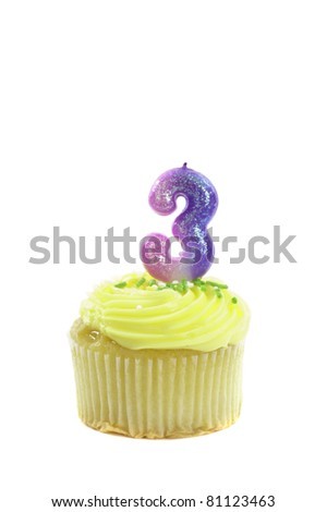 Cupcake with a decorative candle in the form of the number three isolated over a white background to celebrate a birthday or other occasion - stock photo