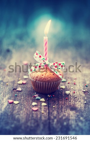 Cupcake with bow and candle - happy birthday card/ Holidays greeting card - stock photo