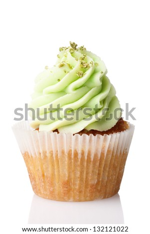 cupcake with green cream isolated on white background