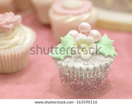 Cupcake with mistletoe decoration - stock photo