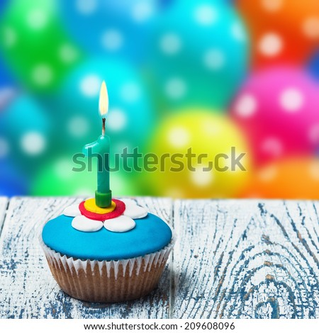 Cupcake with number one on the background of balloons. birthday greetings - stock photo