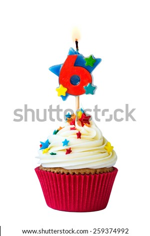 Cupcake with number six candle - stock photo