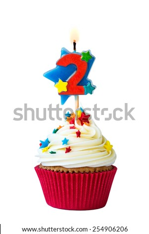 Cupcake with number two candle - stock photo