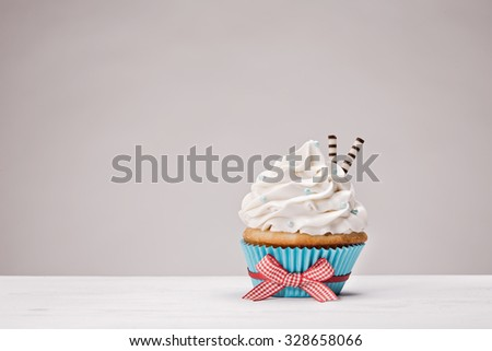 Cupcake with vanilla buttercream icing - stock photo