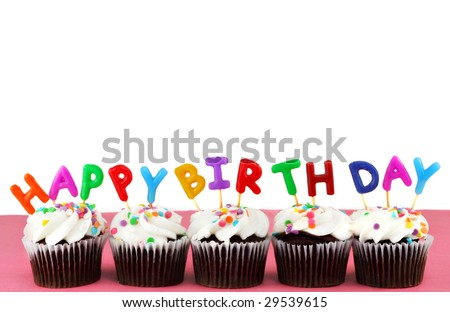 Cupcakes in a row with Happy Birthday candles on top.  Background is white with copy space. - stock photo