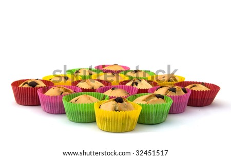 Cupcakes in colorful papers on a white background