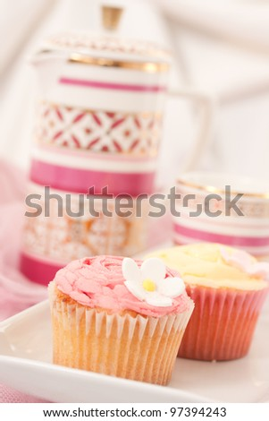 Cupcakes isolated against light background - stock photo