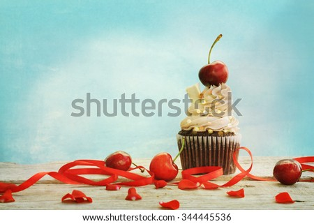cupcakes with a cherry on top - stock photo