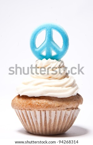 Cupcakes with a peace sign on top - stock photo