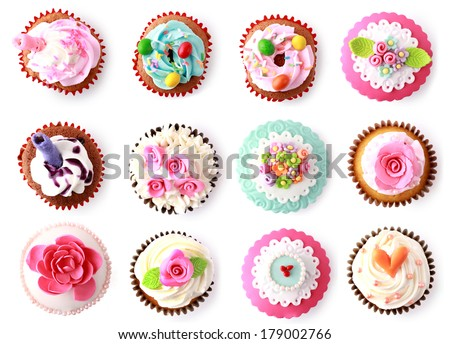 cupcakes with beautiful decoration isolated over white background. shoot from top - stock photo