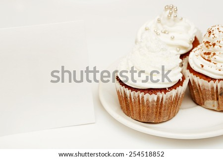 Cupcakes with blank card, Cupcakes with whip cream and blank card - add own text - stock photo