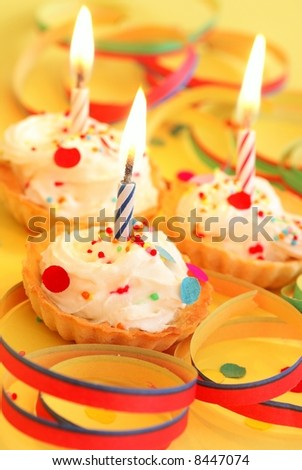 Cupcakes with candles and paper ribbons