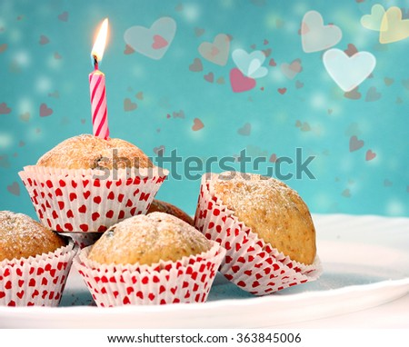 Cupcakes with candles on Valentine's Day - stock photo