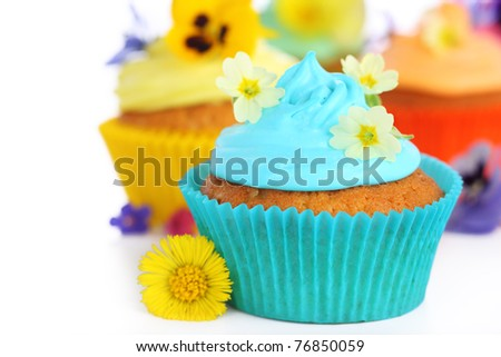 cupcakes with cream and decorated with primrose - stock photo