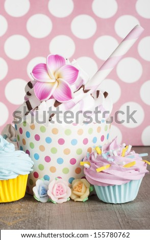 Cupcakes With Flower Decoration And Sprinklers Stock Photo