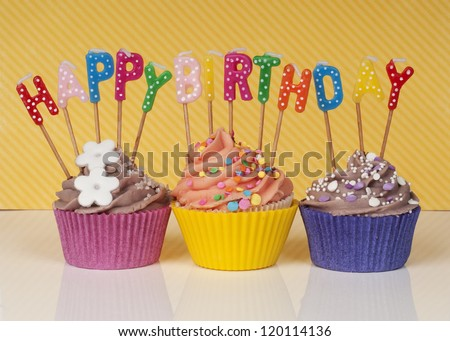 cupcakes with happy birthday candles - stock photo