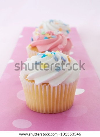 Cupcakes with pink and white icing - stock photo