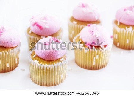 Cupcakes with pink icing isolated on white, selective focus  - stock photo