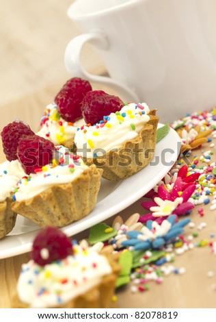 cupcakes with raspberries - stock photo