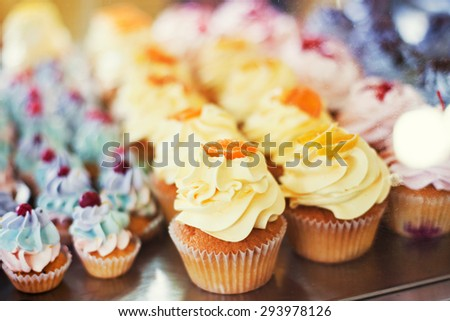 cupcakes with yellow and blue cream - stock photo