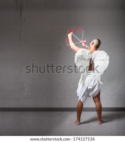 Cupid aiming something - stock photo