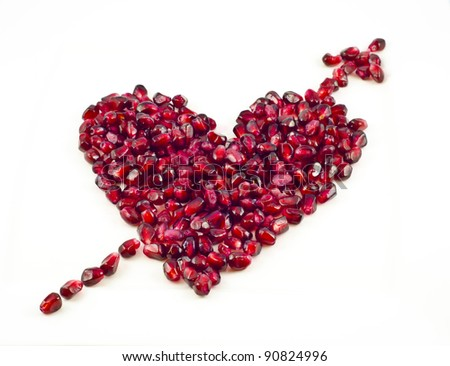 Cupid heart shaped with pomegranate seeds - stock photo