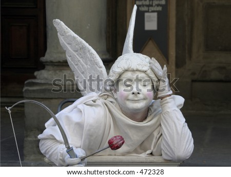 Cupid Mime with eyes closed - stock photo
