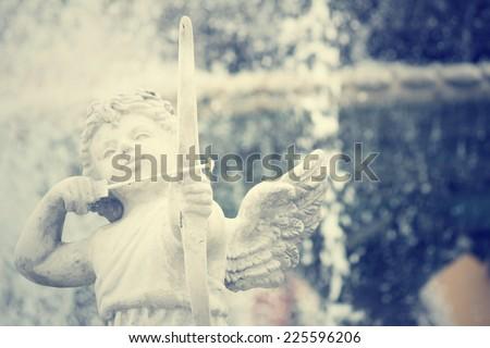 Cupid sculpture  - stock photo