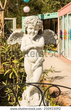 cupid statue - stock photo