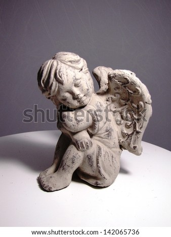 Cupid statue isolated - stock photo