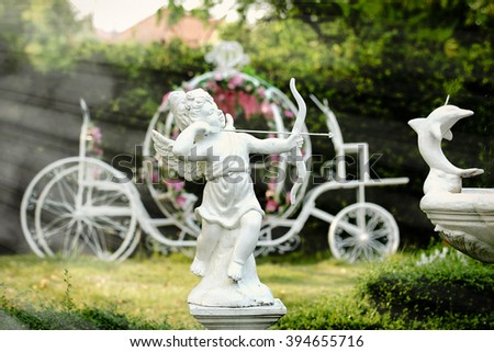 cupid Stone statues with light ray - stock photo